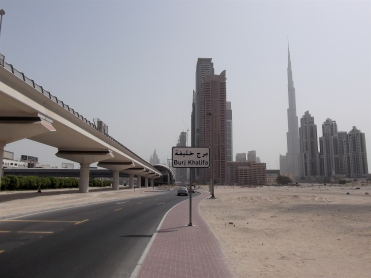 The tallest building in the world -- the spindley one on the right -- the Burj Khalifa